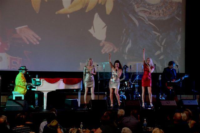 The Flaming Sambucas performing their sensational Elton John tribute show